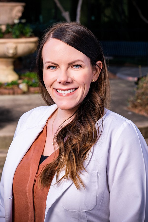 Nurse practitioner Stacy Williams, head shot in white coat